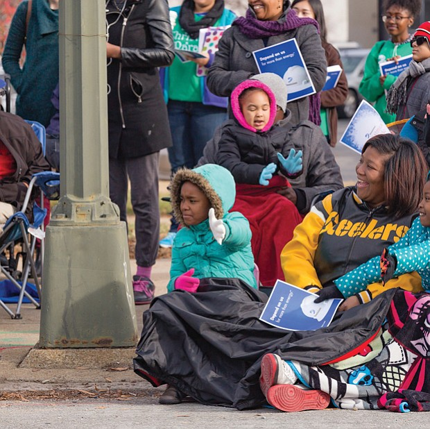 Floats and units in the Dominion Christmas Parade draw cheers from spectators bundled up along Broad Street on Saturday.