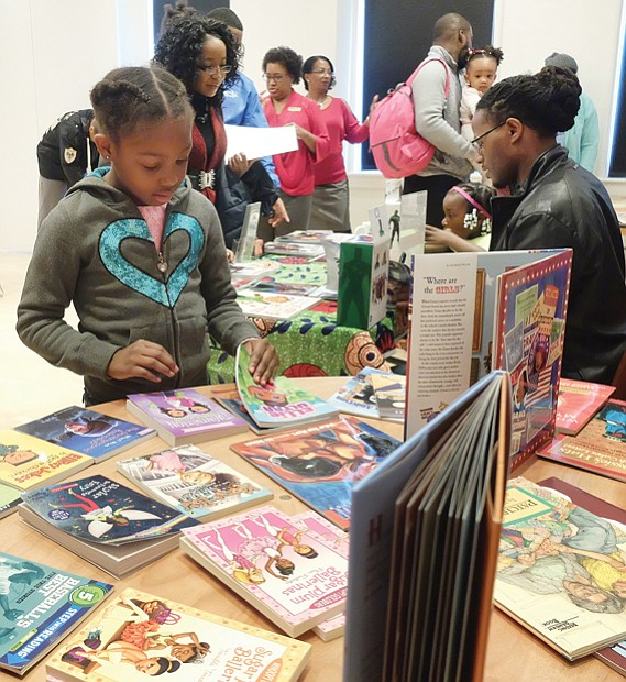 Open house at museum // Dozens of families enjoyed refreshments, arts and crafts, activities and exhibits at the annual Holiday Open House at the Black History Museum and Cultural Center of Virginia, featuring Soul Santa.