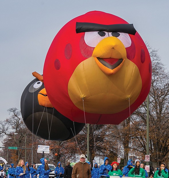 """Angry Birds"" float along the parade route, bringing smiles to the crowd."