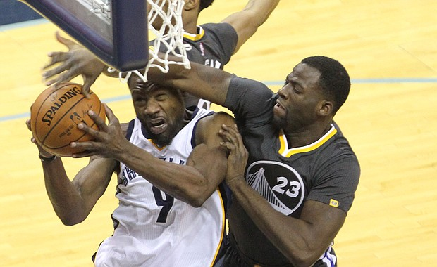Grizzlies SG Tony Allen drives to the basket and is fouled by Warriors PF Draymond Green.