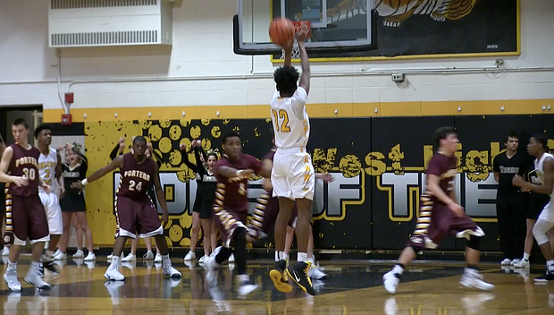 Joliet West forward Charles McKinney hits a three pointer during his team's 74-45 win over Lockport on Tuesday Dec. 13 to remain undefeated at 8-0.