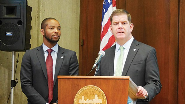 Mayor Martin Walsh speaks about the city's new Climate Ready Boston report as Austin Blackmon, the city's Chief of Environment, Energy and Open Space, looks on.