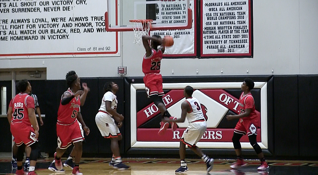 Bolingbrook's Nana Akenten slams down a dunk against Romeoville in the rivalry matchup and his team's 84-55 win.