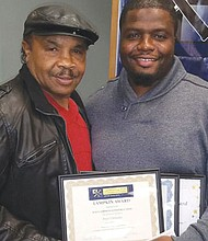 Ray Lampkin (left), the former Portland boxer and current contractor in the construction business, presents the Ray Lampkin pre-apprenticeship award to Peter Chimuku from the organization Constructing Hope.