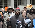 Council Member Jumaane D. Williams (center) stands with Senator Bill Perkins (left), Manhattan Borough President Gale Brewer (right) and tenant advocates during Monday's rally.