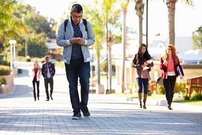 Bill Fletcher says that texting while walking and retreating behind headphones in public are just symptoms of a larger social ...