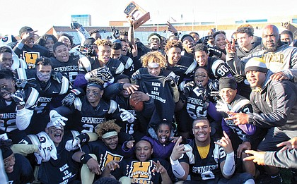Highland Springs High School varsity football players celebrate their back-to-back Division 5 state football championship win on Dec. 10 at Hampton University. The Springers clinched the title for the second time, beating Stone Bridge High School of Loudoun County 35-29.