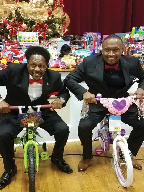 Courtesy of Jay Sharpe Holiday test run Jay Sharpe, right, and Kevin Stallings take a test drive on tricycles that will be given to Richmond children this holiday. The bikes are among 500 gifts donated at Mr. Sharpe's third annual holiday party Dec. 8 to collect toys and presents for youngsters. Location: Trinity Baptist Church on North Side. The toys and gifts will be distributed through the church's Prison Ministry. The event was co-hosted by Mr. Sharpe, a Downtown jeweler, and Antoinette Essa of WTVR CBS 6.