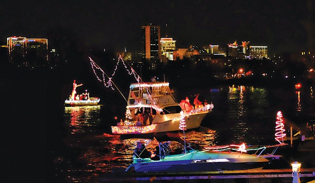 Parade of Lights // Festively decorated boats lighted up the James River and the Richmond skyline Saturday night during the 24th Annual Parade of Lights. About 13 boats participated in the lighted holiday boat parade despite a devastating fire last Friday at the Richmond Yacht Basin that destroyed several boats that were slated to be part of the event.