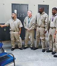 President Obama greets inmates during a visit July 16 to El Reno Federal Correctional Institution in El Reno, Okla.