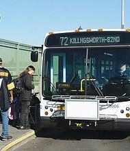 TriMet riders prepare to board the bus on Northeast 82nd Avenue.