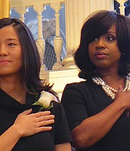 City councilors Michelle Wu, Ayanna Pressley and other returning and entering councilors were sworn in at Faneuil Hall. Wu (l) became the new council president.