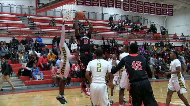 Bolingbrook's Nana Akenten goes up for a bucket against Westinghouse in quarterfinal matchup during the Hinsdale Central Holiday Classic.
