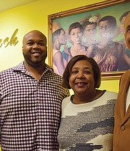(l-r) Haris, Catherine and Danny Hardaway in their Bolling Building store.