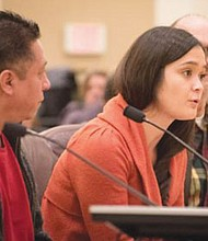 Andrea Miller, executive director of the Causa, a Latino immigrant rights organization in Oregon, testifies before the Multnomah County Commission in support of 'sanctuary county' resolution reaffirming the local government  will not cooperate with federal enforcement of immigration laws.