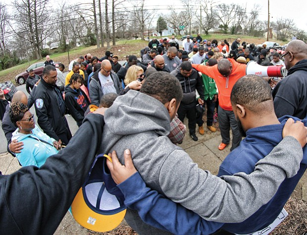 The group known as Coaches Against Violence Everywhere joined in a circle of prayer with community members in Creighton Court in January and spoke out against violence that has claimed the lives of young people in Metro Richmond.