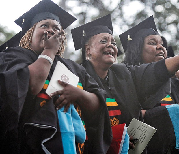 Theology school graduates at Virginia Union University, from left, Donna Cosby, Sheila Dent, Rona Evans and Alice Freeman shed tears of joy during commencement ceremonies in May.