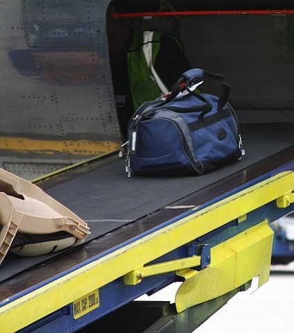 United Airlines is investigating how a baggage handler became trapped in the cargo hold of a regional jetliner during an ...