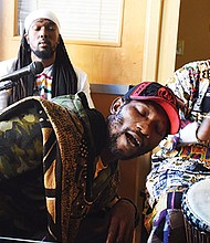 Music groups King Mas of Bantu Movement, Jahrisse of Jah and I Roots Movement and Papahanne of The Humble Brothers played at Suya Joint in Dudley Square during an event celebrating the city's Acoustic Live Entertainment ordinance. The new policy makes it easier for small businesses to host performances.