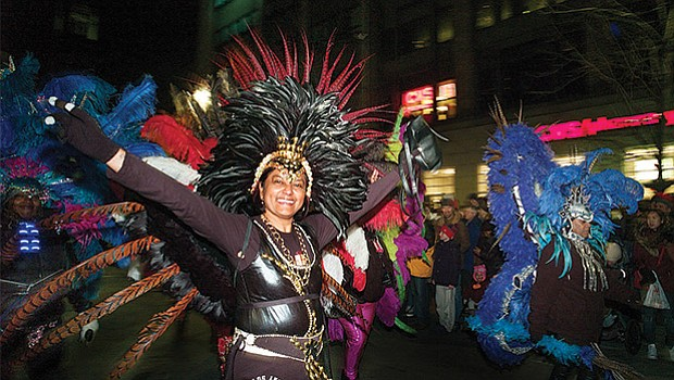 Dancers participate in the First Night parade, which made its way from Copley Square to the Boston Common for the annual celebration.