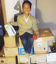 Five-year-old kidpreneur Tyler Stallings with all the donations he collected for MCVET, an nonprofit organization that helps homeless veterans in the Baltimore area.