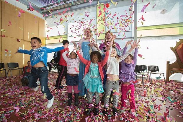 """Party like it's 2017! // Children from around Metro Richmond throw confetti and whoop it up at their own """"Noon Year's Eve Bash"""" last Saturday at the Children's Museum of Richmond. The New Year's Eve celebration, held 12 hours before most adult celebrations, included a grand parade, led by the museum mascot, Seymour the Dinosaur, and a toast with juice boxes. """"Anna"""" and """"Elsa,"""" characters from the highly popular 2013 Disney film """"Frozen,"""" joined the youngsters in ushering in 2017 and learning about New Year's celebrations and customs from around the world."""