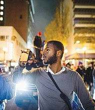 Cameron Whitten, local activist, non-profit director and citizen journalist live streaming a protest in downtown Portland.