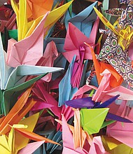 Paper is folded into cranes to represent peace and healing, one of the activities that will take place during a special community service event to pack lunches for kids and a Martin Luther King Jr. remembrance coming to Maranatha Church on the Dr. Martin Luther King Jr. holiday.