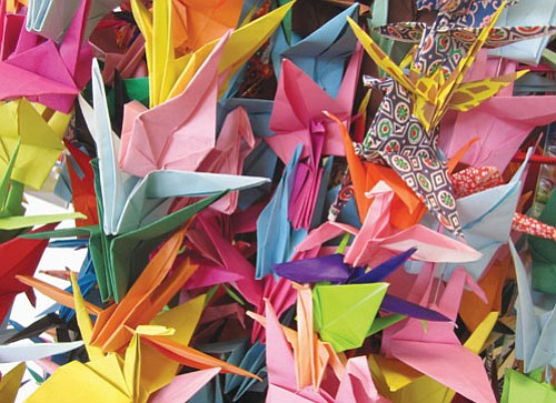 Paper is folded into cranes to represent peace and healing, one of the activities that will take place during a ...