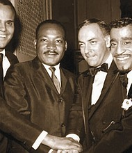Top entertainment stars from1965 are pictured with Dr. Rev. Martin Luther King Jr. (second from left) in this historical photo featuring singer, songwriter and actor Harry Belafonte (far left) film producer Hilliard Elkins (second from right) and entertainer Sammy Davis Jr. (right)