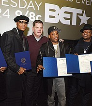 Mayor Martin Walsh presents members of New Edition a Proclamation declaring Sunday, January 8, 2017 as New Edition Day in the City of Boston.
