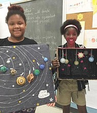 Students in the BELL program focus on topics such as STEM (science, technology, engineering, and math), creative arts, and health and exercise. Pictured are two students showcasing their science projects— models of the solar system.