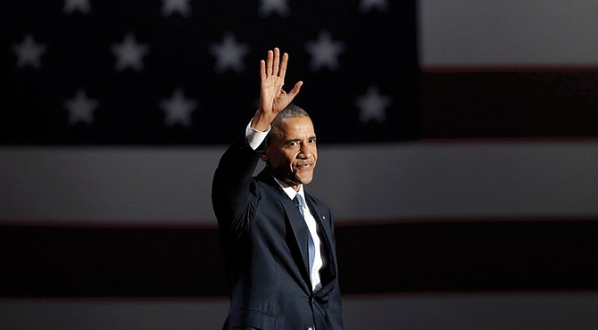 President Obama waves to the crowd as he takes the stage in Chicago on Tuesday to deliver his farewell address.