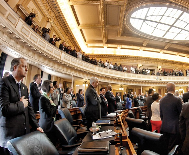 Lawmakers return to Richmond // Left, members of the Virginia House of Delegates recite the Pledge of Allegiance at the state Capitol on Wednesday on the opening day of the new General Assembly session. The 100-member House and 40-member Senate will amend the state budget and deal with more than 2,000 bills during the 46-day session.