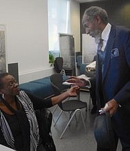 Dorchester residents Rachel Tate and Carl Baty greet each other at a BCYF Grove Hall Senior Center memory cafe.
