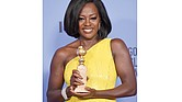 "Actors shine at Sunday's Golden Globe Awards in Beverly Hills, Calif. From left, Viola Davis wins Best Actress for the movie ""Fences,"""