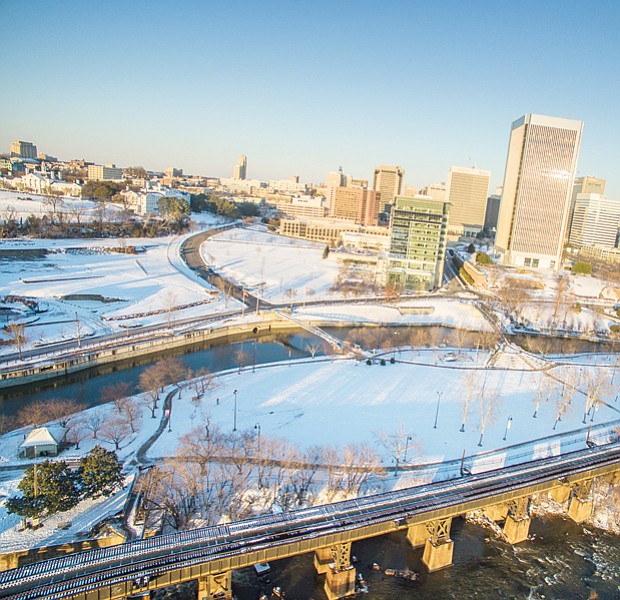Ribbons of clear roads and tracks cut through the snowy landscape in this drone's view of Downtown in Sunday's sunshine.