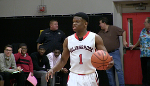 Bolingbrook sophomore guard Joseph Yesufu dribbles the ball during his team's 78-73 win against Homewood-Flossmoor on Friday.