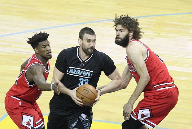 Marc Gasol Drives to the basket on Bulls F Jimmy Butler and Bulls C Robin Lopez.