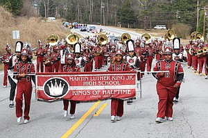 The Martin Luther King Jr. High School Kings of Halftime head down Martin Luther King Parkway in the DeKalb NAACP's annual parade to honor the civil rights icon.