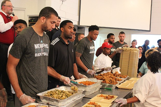 Brandan Wright, Jarell Martin and Grizzlies staffers work the chow line at the Memphis Union Mission.