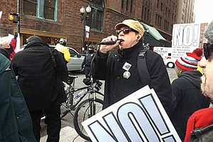 Tedd Sirot, Initiator for the Refuse Fascism group in Chicago speaks at a recent protest held at the Chicago Club located in the loop. Photo Credit: Gregg Greer