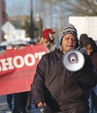 Red Hamilton of Don't Shoot PDX leads a Reclaim Martin Luther King March Sunday down Northeast Martin Luther King Jr. Boulevard to the King statute at the Oregon Convention Center.