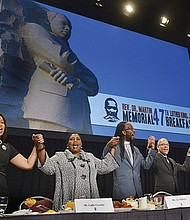 """The conclusion of the annual Martin Luther King Jr. Breakfast singing of """"We Shall Overcome,"""" the civil rights anthem, was sung with particular purpose in this time of political uncertainty by keynote speaker Callie Crossley (second from left), co-chair Rev. Jay Williams, master of ceremonies Jose Masso and co-chair Rev. Dr. Monrelle Williams. Speeches were given by Rep. Ed Markey, Attorney General Maura Healey, Sen. Elizabeth Warren and state Sen. Chang-Diaz, among others."""