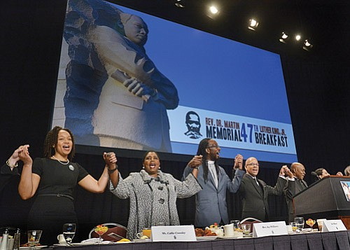 "The conclusion of the annual Martin Luther King Jr. Breakfast singing of ""We Shall Overcome,"" the civil rights anthem, was sung with particular purpose in this time of political uncertainty by keynote speaker Callie Crossley (second from left), co-chair Rev. Jay Williams, master of ceremonies Jose Masso and co-chair Rev. Dr. Monrelle Williams. Speeches were given by Rep. Ed Markey, Attorney General Maura Healey, Sen. Elizabeth Warren and state Sen. Chang-Diaz, among others."