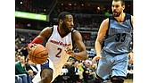 Washington Wizards guard John Wall (2) drives past Memphis Grizzlies center Marc Gasol (33) during the second half.