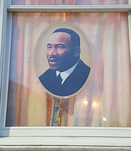 Window of home in Baltimore City decorated to commemorate MLK Day
