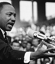"""Martin Luther King Jr., addresses a crowd from the steps of the Lincoln Memorial where he delivered his famous, """"I Have a Dream,"""" speech during the August 28, 1963 March on Washington for Jobs and Freedom in Washington, D.C."""