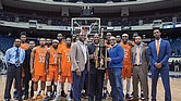 The Virginia State University Trojans show off their trophy following their 74-59 win over Virginia Union University in last Sunday's Freedom Classic at the Richmond Coliseum. Holding the trophy are, from left, Richmond Mayor Levar M. Stoney, VSU basketball Coach Lonnie Blow and VSU President Makola M. Abdullah.