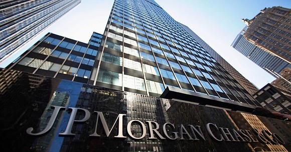 JPMorgan Chase said Wednesday that it had agreed to settle a federal lawsuit accusing the bank of working with mortgage ...